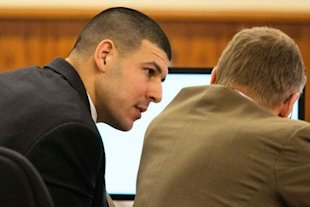Aaron Hernandez consults his attorney during his murder trial. (REUTERS)