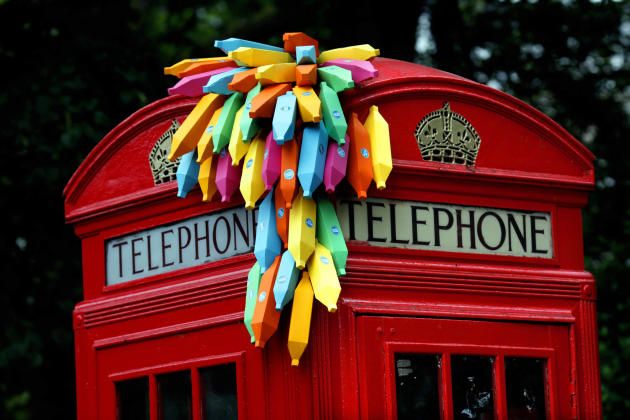 An installation of paper bananas attached to a public telephone box, created by Brazilian graphic artist Breno Pineschi as part of as part of the arts campaign 'Rio Occupation London', is seen in Sout