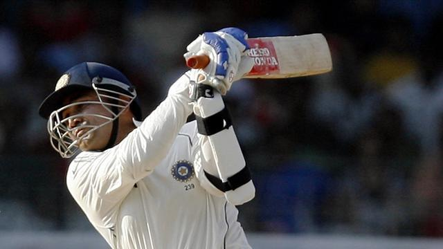 Cricket - Sehwag hits ton as England graft against India