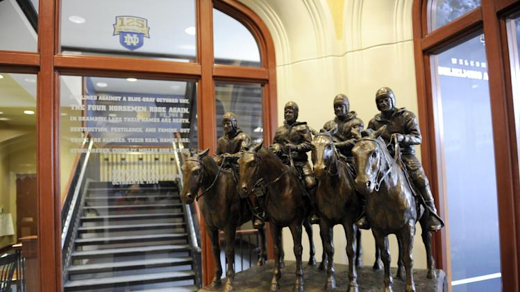 In this Dec. 27, 2012, photo, a statue of the Four Horseman is displayed in the lobby of the Guglielmino Athletics Complex on the campus of the University of Notre Dame in South Bend, Ind. (AP Photo/Joe Raymond)