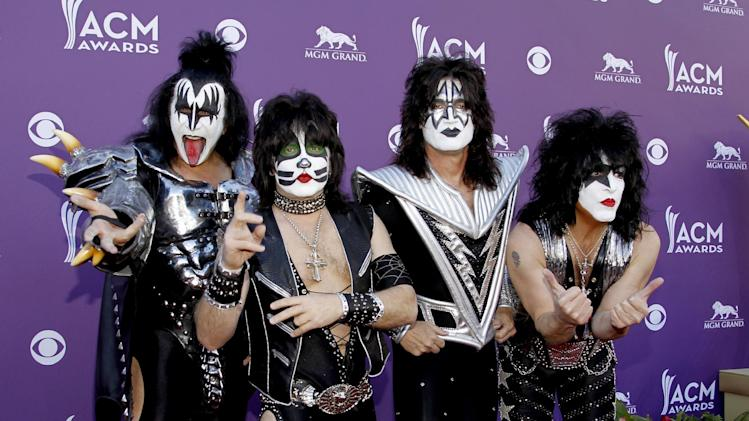 FILE - In this Sunday, April 1, 2012 file photo, from left, Gene Simmons, Eric Singer, Tommy Thayer and Paul Stanley, of the musical group KISS, arrive at the 47th Annual Academy of Country Music Awards in Las Vegas. KISS will perform at the NHL game at Dodger Stadium on Jan. 25, 2014. The NHL said Thursday, Jan. 2, 2014 that the rock band will play during the pregame festivities and first intermission of the Stadium Series game between the Los Angeles Kings and Anaheim Ducks. (AP Photo/Isaac Brekken, File)