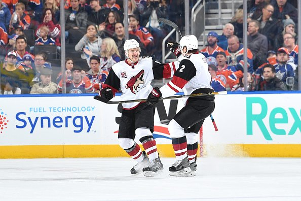 EDMONTON, AB - NOVEMBER 27: Jamie McGinn #88 and Luke Schenn #2 of the Arizona Coyotes celebrate after a goal during the game against the Edmonton Oilers on November 27, 2016 at Rogers Place in Edmonton, Alberta, Canada. (Photo by Andy Devlin/NHLI via Getty Images)