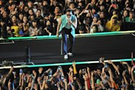 "South Korean singer Park Jae-Sang, also known as Psy, performs during his free concert in Seoul on October 4, 2012. Psy brought his hit ""Gangnam Style"" home Thursday with a raucous free concert in Seoul, capping a month of global chart success that turned the chubby 34-year-old into a national hero"