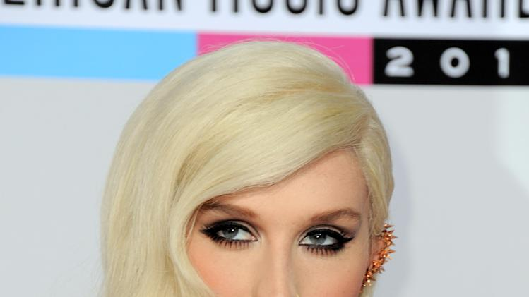 Ke$ha arrives at the 40th Anniversary American Music Awards on Sunday, Nov. 18, 2012, in Los Angeles. (Photo by Jordan Strauss/Invision/AP)