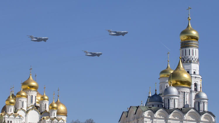 Russian military transport planes fly over the Kremlin during Victory Day Parade at the Moscow Red Square, Russia, Thursday, May 9, 2013. (AP Photo/Misha Japaridze)