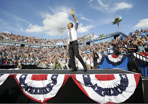 President Barack Obama waves as takes the stage at a campaign event at Delray Beach Tennis Center, Tuesday, Oct. 23, 2012 in Delray Beach, Fla., the day after the last presidential debate against Repu
