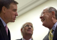 From left, Sen. Mark Warner, D-Va., Sen. Roger Wicker, R-Miss., and Sen. Lamar Alexander, R-Tenn., talk in the hall before a news conference on Capitol Hill in Washington, Wednesday, Nov. 16, 2011. (AP Photo/Carolyn Kaster)