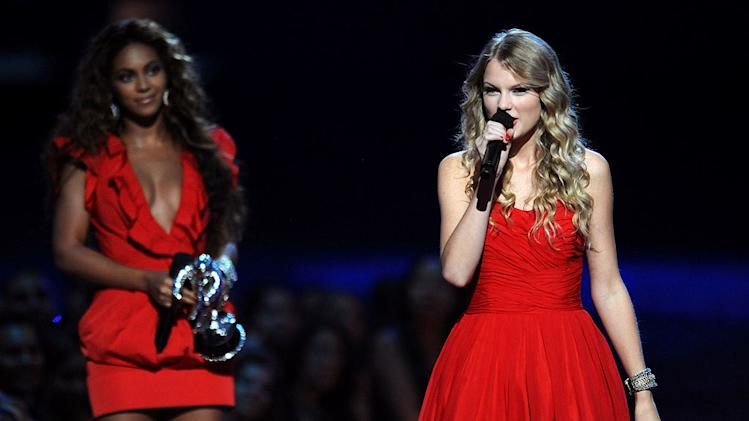 Singer Taylor Swift speaks onstage after Beyonce allowed her to finish her speech that was interrupted by Kanye West earlier in the showd during the 2009 MTV Video Music Awards at Radio City Music Hall on September 13, 2009 in New York City.