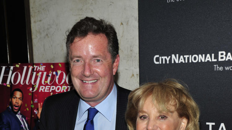 From left, Piers Morgan and Barbara Walters seen on the red carpet for The Hollywood Reporter Celebrates the 35 Most Powerful People in Media, on April 10th, 2013, in New York. (Photo by Charles Sykes/Invision for The Hollywood Reporter/AP Images)