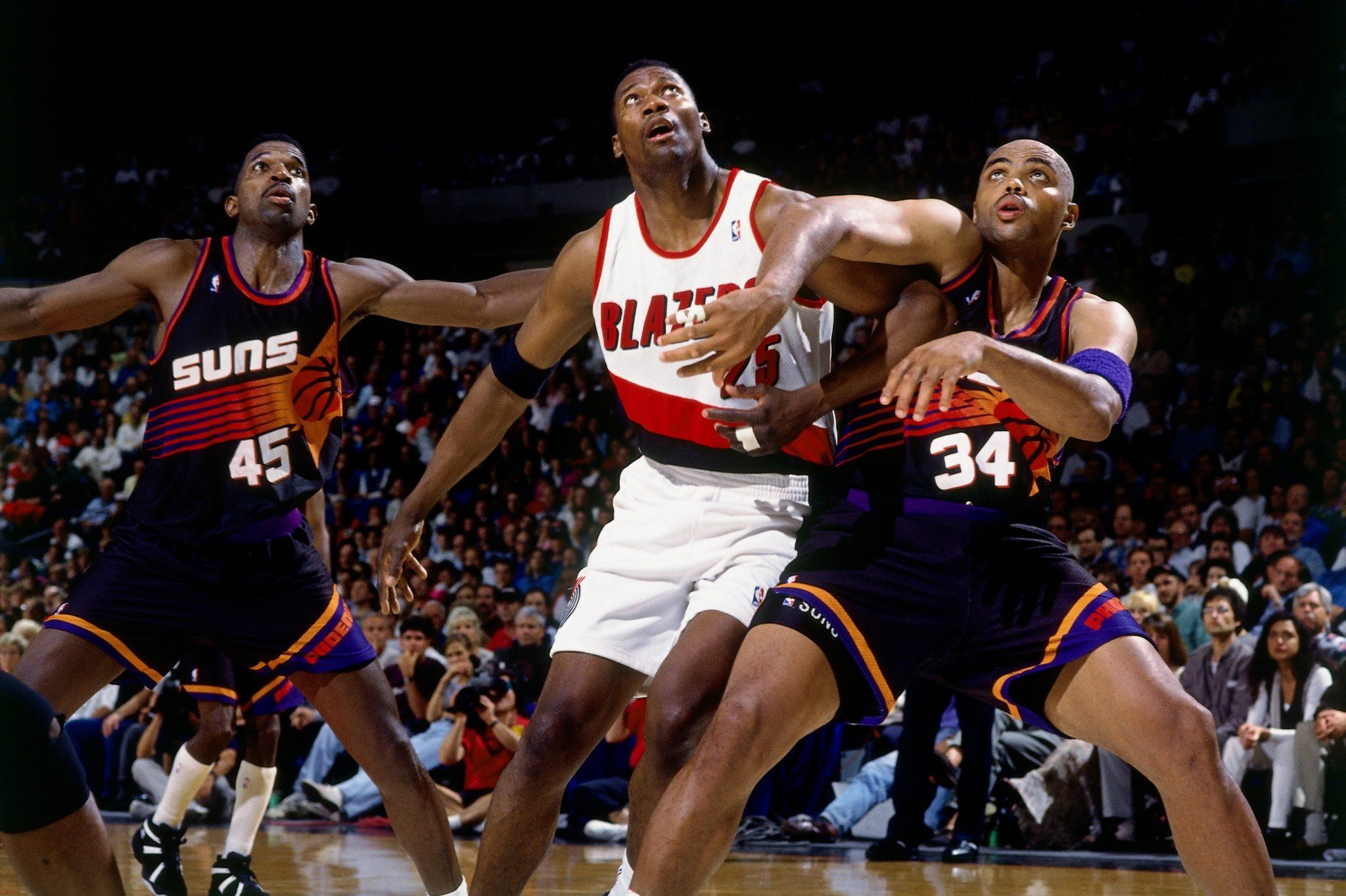 Jerome Kersey (center) battles A.C. Green (left) and Charles Barkley for rebounding position during the 1995 Western Conference Quarterfinals. (Andrew D. Bernstein/NBAE/Getty Images)