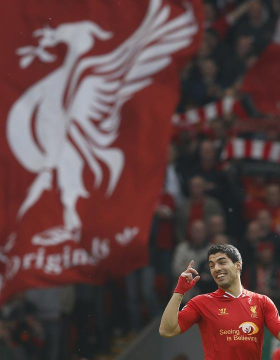 Liverpool's Suarez reacts ahead of their English Premier League soccer match against Tottenham Hotspur at Anfield in Liverpool