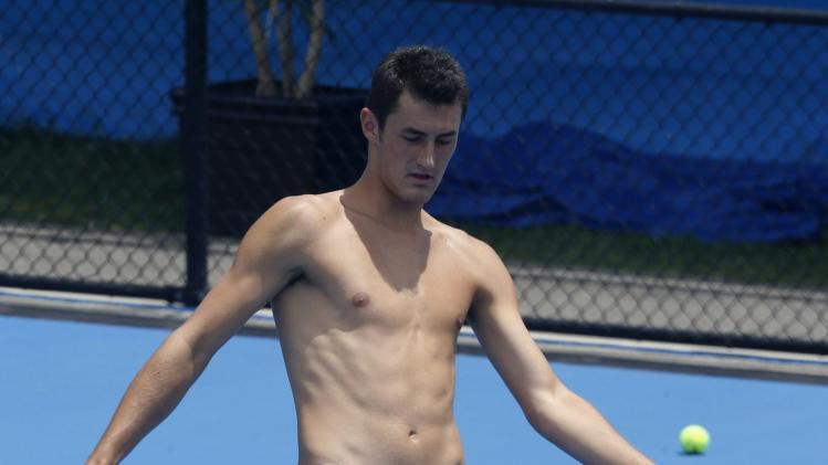 Australia's Tomic trains with a soccer ball on the court before his men's singles semi-final match against Ukraine's Stakhovsky at the Sydney International tennis tournament
