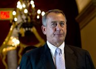 US House Speaker John Boehner arrives at the House of Representatives chamber at the US Capitol on September 28, 2013 in Washington
