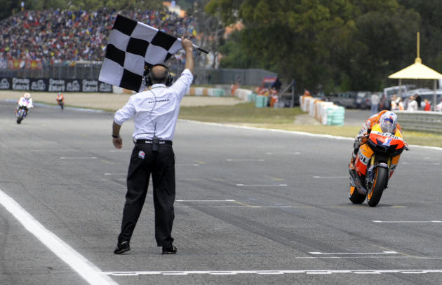 Repsol Honda team's Australian Casey Stoner crosses the finish line to win the Moto GP race of the Portuguese Grand Prix in Estoril, outskirts of Lisbon, on May 6, 2012. Stoner won the race ahead Span