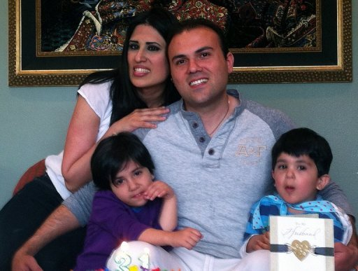 This undated handout photo courtesy of the American Center for Law and Justice shows Iranian convert to Christianity Saeed Abedini with his wife Naghmeh and their two children. A Tehran court on Sunday sentenced an Iranian-American pastor to eight years in prison over his role in underground churches in the Islamic nation, a US group supporting him said