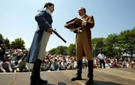 Duellists inspect their pistols in a 2004 reenactment for the 200th anniversary of a historic duel which mortally wounded US founing father Alexander Hamilton in Weehawken, New Jersey. Live pigeon shooting, pistol duelling and club swinging won't feature at the London Olympics, but there was a time when they were all medal events