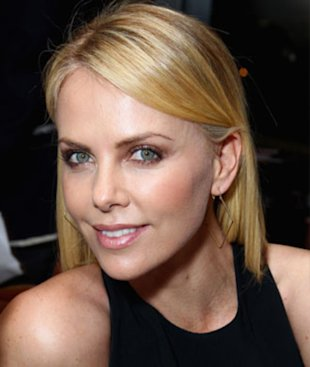 Charlize Theron wearing smoky eyes.