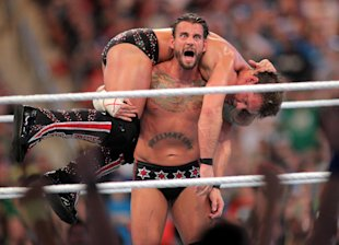 C.M. Punk competes against Chris Jericho at WrestleMania XXVIII on April 1, 2012. (AP)