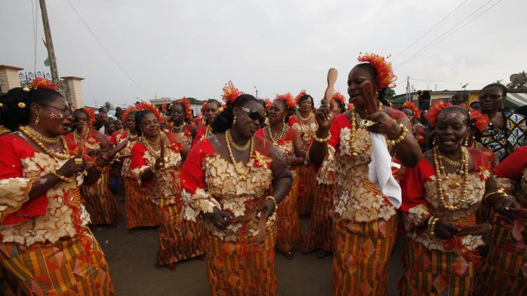 Women take part in a procession through the streets during the Generation Festival in Anoumabo, in Abidjan
