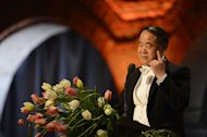 China's Mo Yan, the 2012 Nobel Prize winner in literature, delivers a speech during a banquet after the award ceremony. The 2012 Nobel laureates in medicine, literature, economics, physics and chemistry received their prizes from Swedish King Carl XVI Gustaf at a gala ceremony in Stockholm on Monday