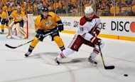 Shane Doan (R) of the Phoenix Coyotes carries the puck in front of Kevin Klein of the Nashville Predators in game four of the Western Conference second-round NHL playoff series on May 4. The Coyotes edged the Predators 1-0