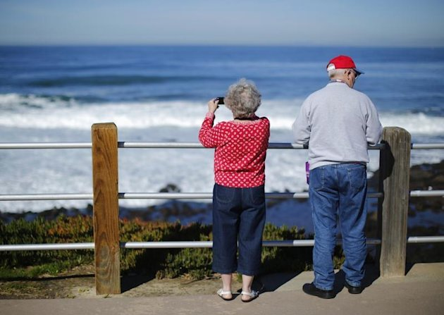 A retired couple take in the ocean during a visit to the beach in La Jolla, California January 8, 2013. REUTERS/Mike Blake