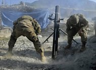 US army soldiers fire mortar rounds towards insurgent positions at Outpost Monti in Kunar province in 2011. A Taliban rocket attack on a NATO base in the eastern Afghan province of Kunar killed two international soldiers and wounded six, officials said