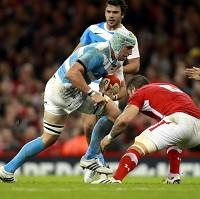 Argentina's Leonardo Senatore is tackled by Wales' Josh Turnbull at the Millennium Stadium