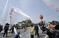 North Korean defectors, now living in South Korea, prepare to release balloons carrying anti-N.Korean leaflets to mark the centenary anniversary of the birth of the late founder of DPRK, Kim Il-Sung, at Imjingak peace park in Paju near the Demilitarized zone (DMZ) separating the two Koreas, on April 15
