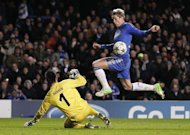 Chelsea striker Fernando Torres (R) goes around FC Nordsjaelland goalkeeper Jesper Hansen to score in the UEFA Champions League Group E match at Stamford Bridge. Chelsea became the first defending champions to be eliminated from the Champions League at the group phase despite thrashing FC Nordsjaelland 6-1