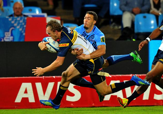 Australia's ACT Brumbies fullback Jesse Mogg (L) is by a South-Africa's Northern Bulls' player during the Super 15 Rugby union match between Northern Bulls and ACT Brumbies at the Loftus Versfeld stad