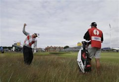 Adam Scott of Australia prepares to play out of the rough on the 18th hole at Royal Lytham & St Annes golf club during the first round of the British