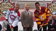 Montreal Canadiens defenceman Josh Gorges, NHL commissioner Gary Bettman and Flames defenceman Steve Staios show off the jerseys to be worn at the Feb. 20 Heritage Classic game in Calgary.