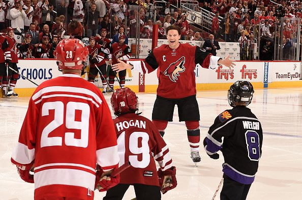 GLENDALE, ARIZONA - APRIL 02: Shane Doan #19 of the Arizona Coyotes skates through a tunnel of youth hockey players during an awards ceremony prior to a game against the Washington Capitals at Gila River Arena on April 2, 2016 in Glendale, Arizona. (Photo by Norm Hall/NHLI via Getty Images)