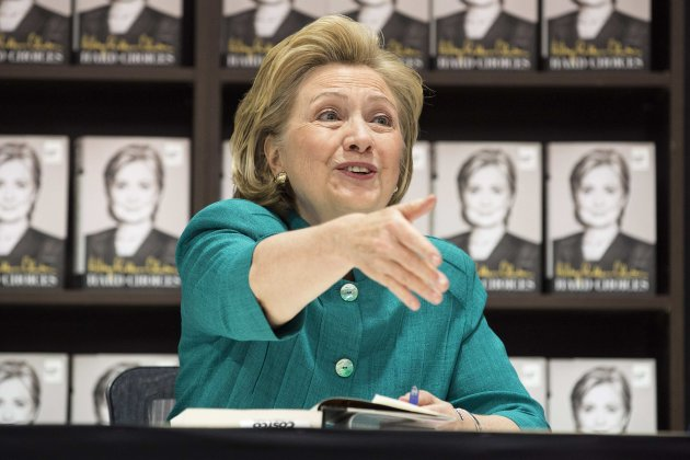 """Former U.S. Secretary of State Hillary Clinton greets people as she signs copies of her book """"Hard Choices"""" at a Costco store in Arlington, ..."""