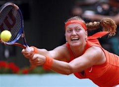 Czech Republic's Patra Kvitova stretches to returns the ball to China's Li Na during their fourth round match of the French Open tennis tournament, at