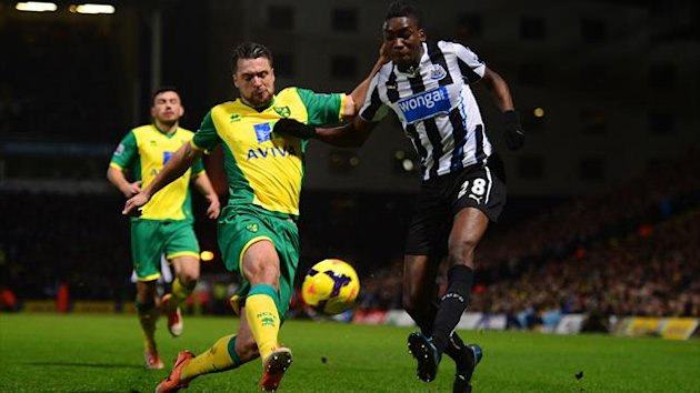 Sammy Ameobi of Newcastle United and Russell Martin of Norwich City compete for the ball during the Barclays Premier League match between Norwich City and Newcastle