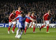 Chelsea's Frank Lampard scores a penalty against Benfica during their UEFA Champions League quarter finals football match at Stamford Bridge, West London. Chelsea survived a nervous finale against 10-man Benfica to earn a 2-1 win in the Champions League quarter-final second leg and set up a last-four showdown with holders Barcelona