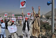 Afghan demonstrators shout slogans during an anti-US protest against an anti-Islam movie in Kabul on September 20. Hundreds of Afghans on Thursday protested for the first time against cartoons of the prophet Mohammed published in France and staged fresh rallies against a US-made anti-Islam film