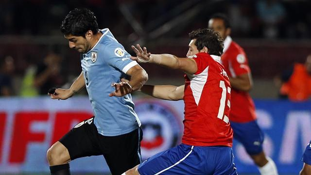 South American Football - Luis Suarez courts controversy with 'punch'