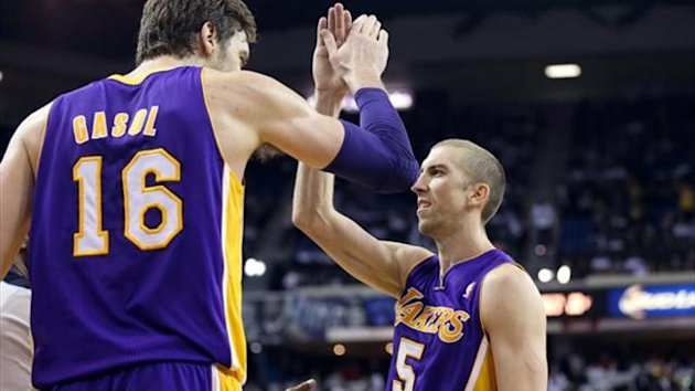 Los Angeles Lakers center Pau Gasol (16) high fives point guard Steve Blake (5) (Reuters)