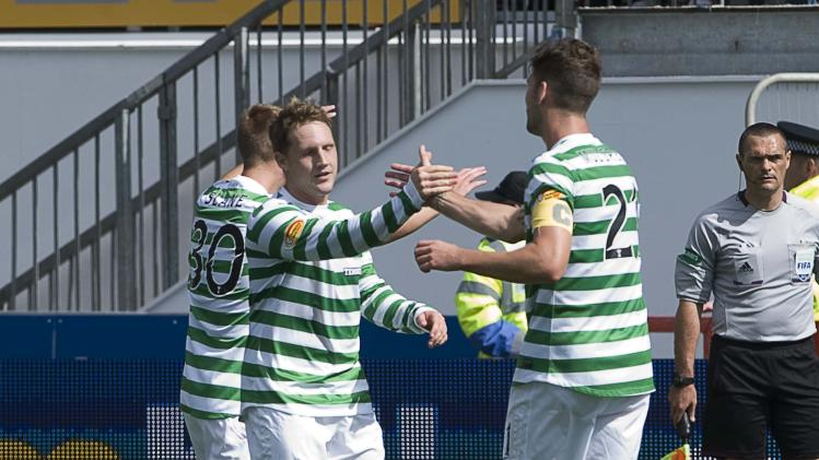 Kris Commons, centre, rescued a point for Celtic with a late equaliser
