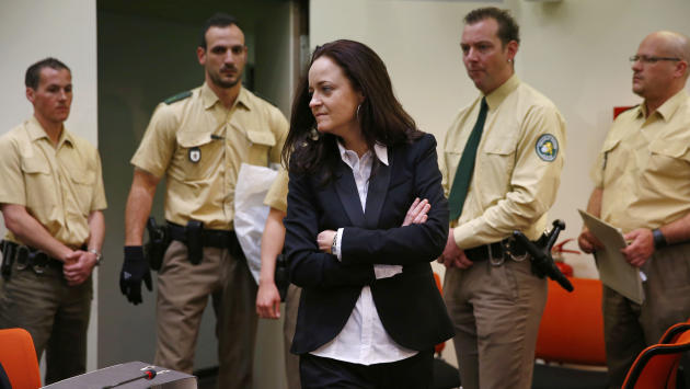 Beate Zschaepe, member of the neo-Nazi group National Socialist Underground (NSU) enters the court room before the start of her trial in Munich, southern Germany, Monday, May 6, 2013. The highest-prof