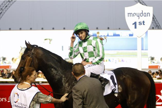 "Moore, riding Lines of Battle of the U.S., gestures after winning the fourth race ""UAE Derby"" during the Dubai World Cup at the Meydan Racecourse in Dubai"