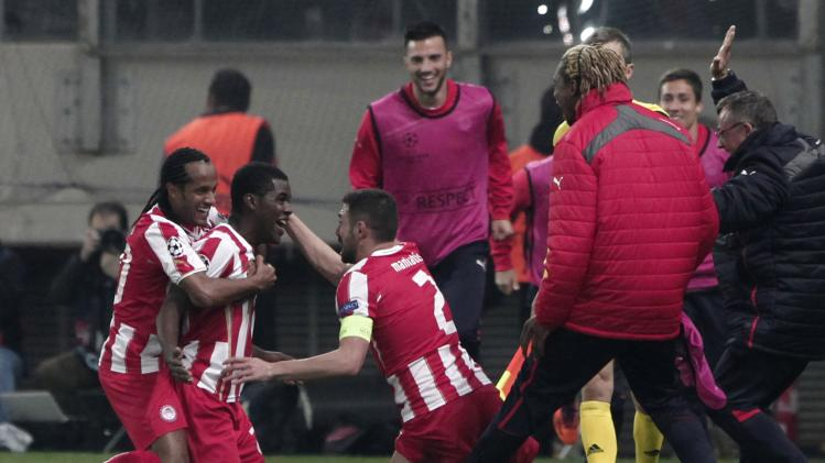 Olympiakos' Campbell celebrates with his teammates after scoring a goal during their Champions League round of 16 first leg soccer match against Manchester United at Karaiskaki stadium in Piraeus, near Athens