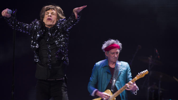 Mick Jagger, left, and Keith Richards of The Rolling Stones perform in concert on Saturday, Dec. 8, 2012 in New York. (Photo by Charles Sykes/Invision/AP)