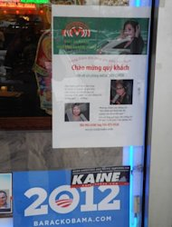 A sign on the front of a restaurant encourages votes for President Barack Obama and Democratic Senate hopeful Tim Kaine -- while another advertisement promotes a Vietnamese music program -- at the Eden Center shopping complex in the Washington suburb of Falls Church, Virginia, on October 28, 2012