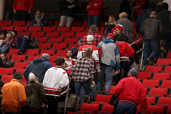 RALEIGH, NC - DECEMBER 19: Fans leave the building following an announcement that an NHL game between the Carolina Hurricanes and the Detroit Red Wings is postponed due to a mechanical failure in the system that makes the ice surface on December 19, 2016 at PNC Arena in Raleigh, North Carolina. (Photo by Gregg Forwerck/NHLI via Getty Images)
