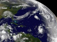 Tropical Storm Isaac moving over the Mississippi Valley, and Hurricane Kirk and Tropical Storm Leslie on August 31. US forecasters warned Wednesday that former tropical storm Leslie had swollen to become hurricane, the sixth of the Atlantic season