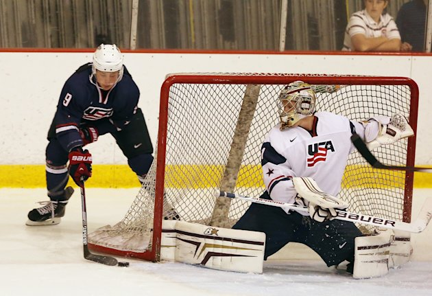 LAKE PLACID, NY - AUGUST 02: Jack Eichel #9 of USA Blue is stopped by Thatcher Demko #1 of USA White during the 2014 USA Hockey Junior Evaluation Camp...